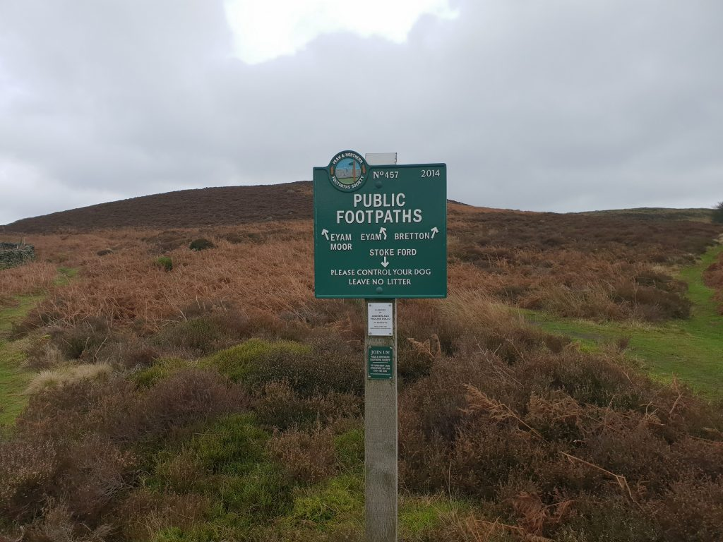 A Green public footpath sign on the Moors
