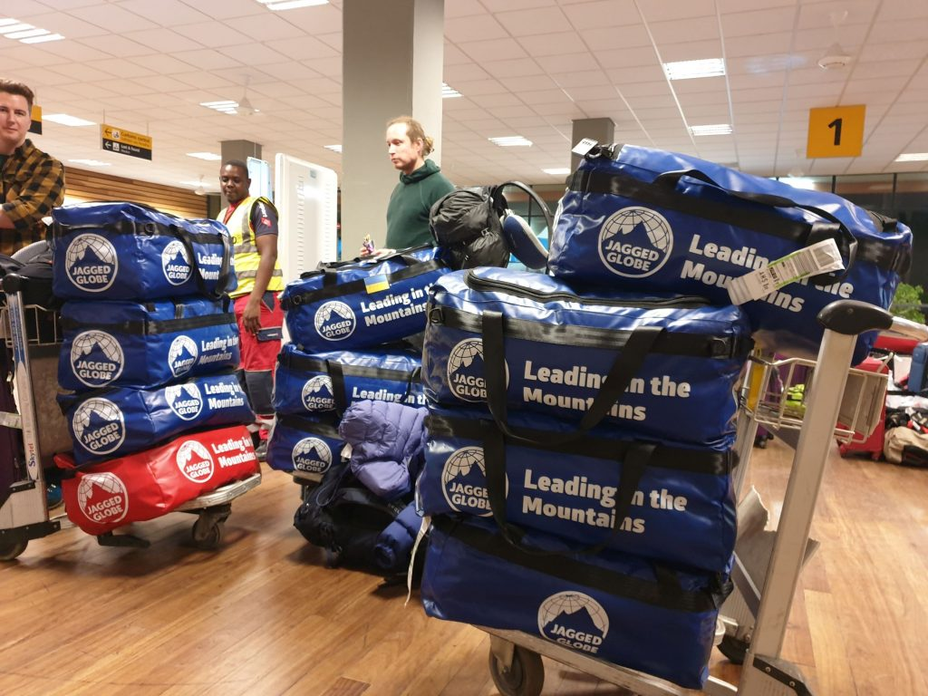 Kit bags piled on luggage trollies