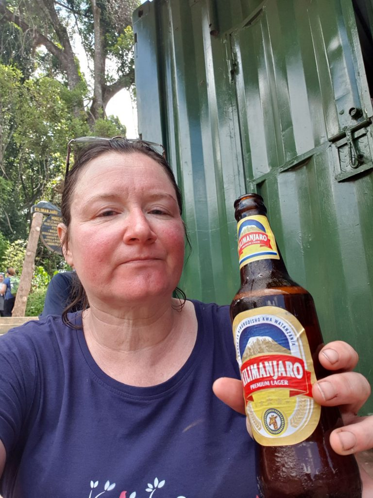 Me, drinking a beer at the end of the trek, looking rather tired