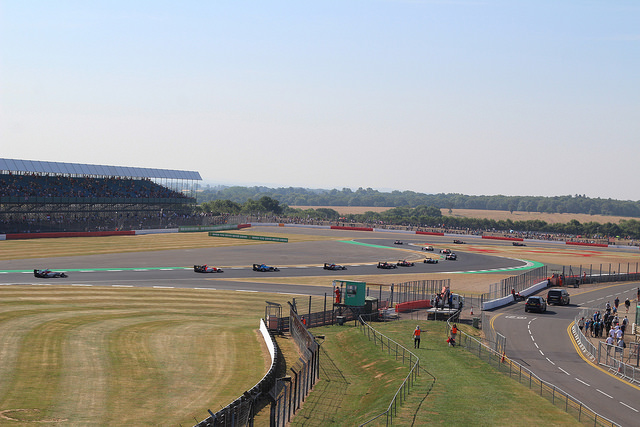 Parade of cars along Silverstone circuit