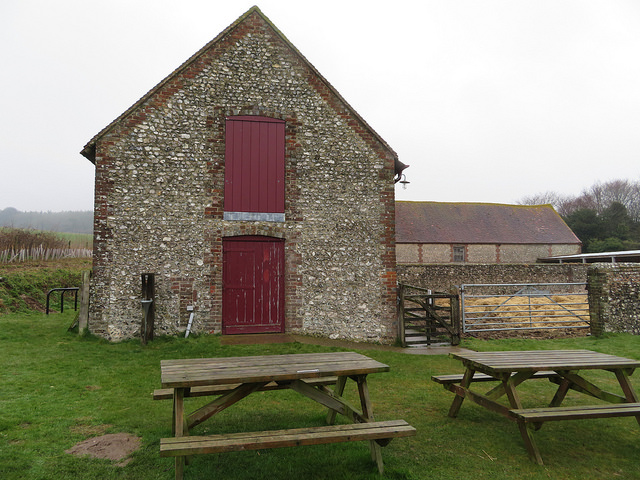 Stone barn, with wooden benches in front of it