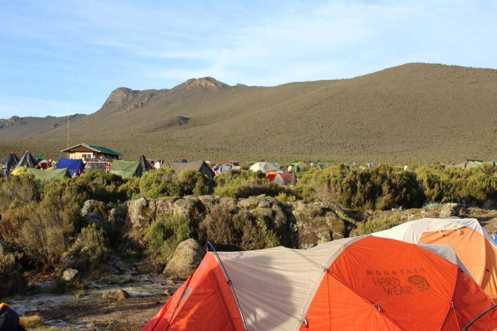 A wider view of the campsite, with hills in the background