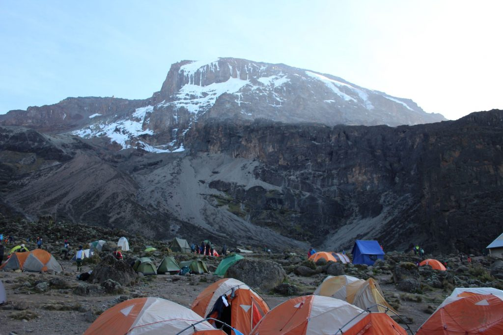View over campsite, with the Baranco wall cliff at the back of the Camp.  Mountain peak behind
