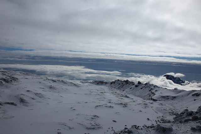 Snow and glaciers on the top of the mountain, Looking out across the clouds,