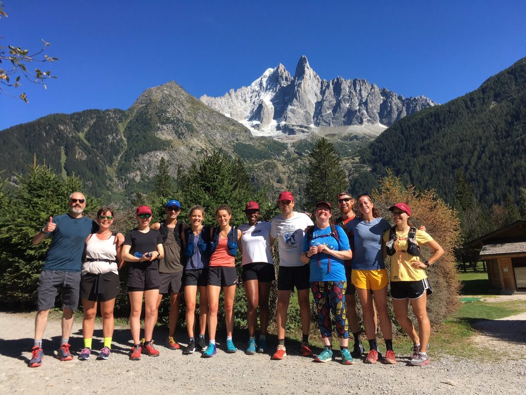 A group of runners posed, in the mountains